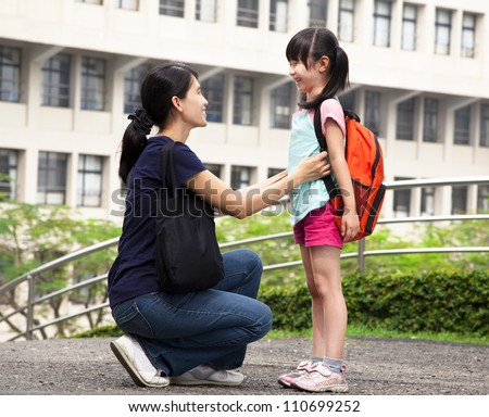 back to school.happy asian mother with daughter in school - stock photo