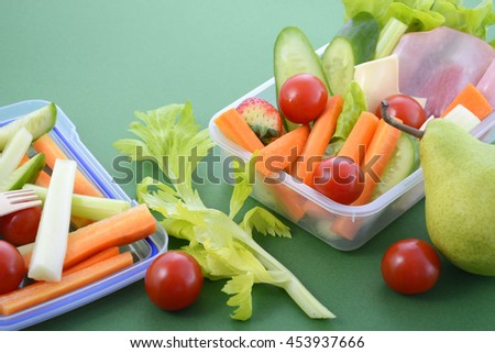 Back to school healthy school lunch box on green background.  - stock photo
