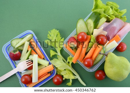 Back to school healthy school lunch box on green background with copy space.   - stock photo