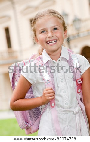 Back to school - little girl going to school - stock photo