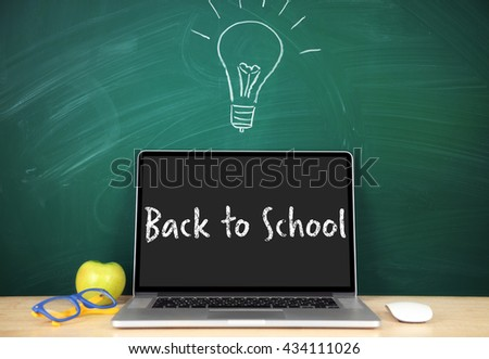 Back to school message on screen of laptop - stock photo