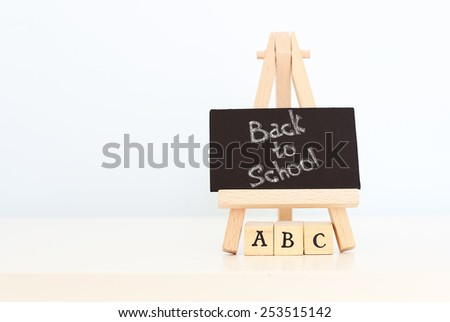 Back to school  photo with text on chalkboard - stock photo