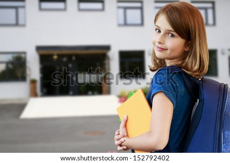 Back to school - portrait of beautiful young schoolgirl, education concept - stock photo