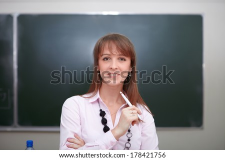 Back to school. Portrait of teacher with chalk. - stock photo