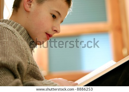 Back to school. Portrait of young boy studying - stock photo