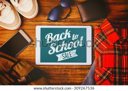 Back to school sale message against tablet shirt jean shoes smartphone wallet and bag - stock photo
