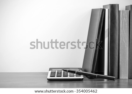 Back to school, school books with apple on desk - stock photo