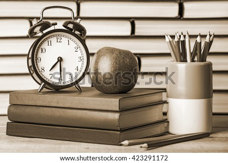 Back to school, school books with apple on desk. The Old style sepia. - stock photo