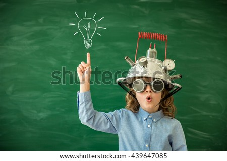 Back to school. Schoolchild with virtual reality headset. Child in class. Funny kid against blackboard. Nerd kid having fun. Geek child with VR glasses. Innovation technology and education concept