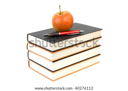back to school: stack of books with apple and pen on top over white background