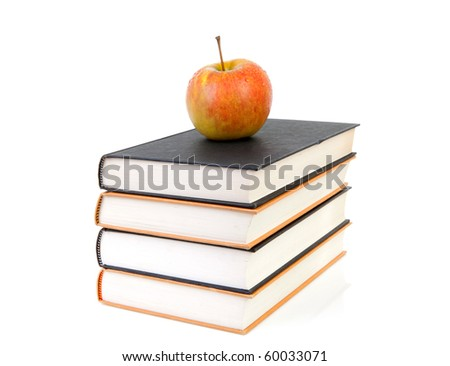 back to school: stack of books with apple on top over white background