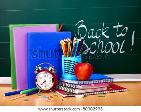 Back to school supplies and board. - stock photo