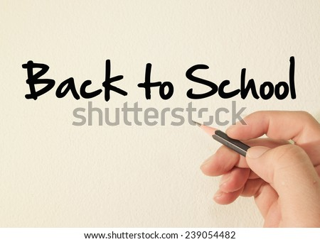 Back to school text write on wall  - stock photo