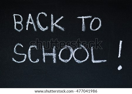 back to school title written on a blackboard. sign for the beginning of a school year