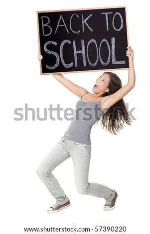 Back to school / university / college. Excited university student holding chalkboard saying back to school. Young female model. Isolated on white background. - stock photo