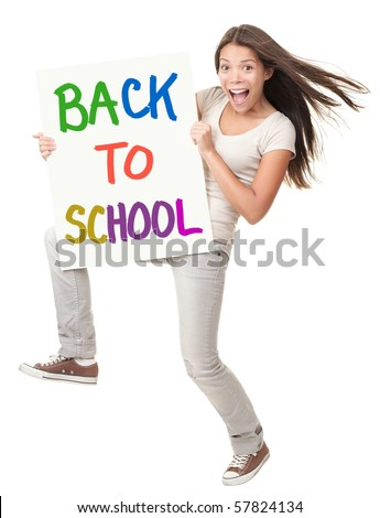 Back to school / university / college. Female student holding a sign saying Back to School. Happy excited screaming white / chinese woman isolated on white background in full length - stock photo