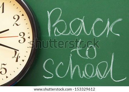 Back to school. Watch against a school board. - stock photo