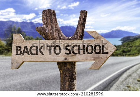 Back to School wooden sign with a street on background  - stock photo