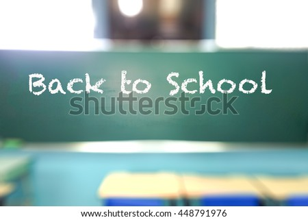 Back to school word on blackboard in classroom of elementary school to welcome students  back to beginning of semester with blurred background bokeh effect.