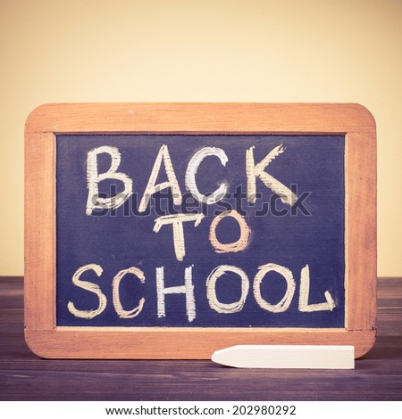Back to School written on a blackboard. Retro style filtered photo - stock photo