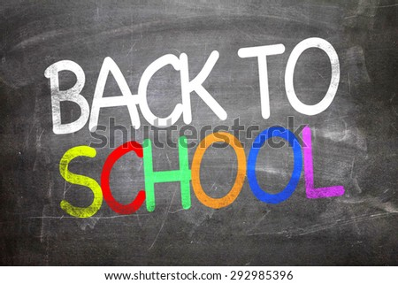 Back to School written on a chalkboard - stock photo