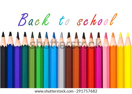 Back to school written on white background with colorful wooden pencils