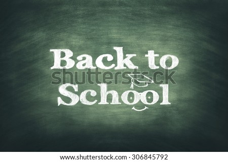 back to school written with chalk - stock photo
