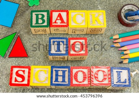Back to school written with wooden letters and learning tools