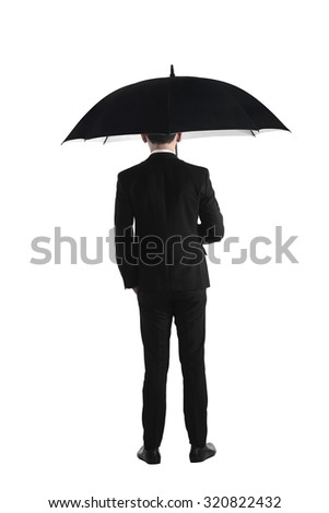 Back view business man standing holding umbrella isolated over white background - stock photo