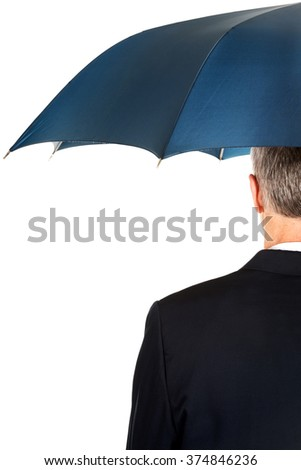 Back view businessman with umbrella - stock photo