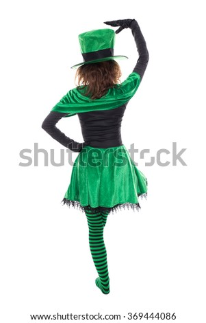 Back view from a dancing leprechaun, isolated on white, concept ireland and st. patrick´s day - stock photo