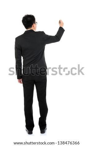 Back view full body picture of an Asian business man writing something on glass boar with marker standing isolated on white background - stock photo