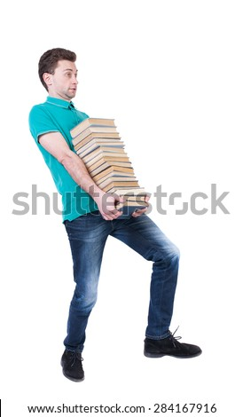 Back view going  handsome man carries a stack books. walking young guy . Rear view people collection. backside view person. Isolated over white background. High school student carries book in library - stock photo