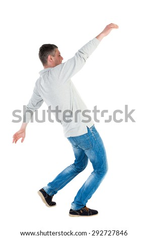 Back view man Balances waving his arms. Rear view people collection. backside view of person.  Isolated over white background. A guy in a gray jacket waving his arms in the fall. - stock photo