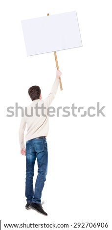 Back view man showing sign board. man holds information plate. Rear view people collection. backside view person. Isolated over white background. guy in white sweater on strike with placard in hand  - stock photo
