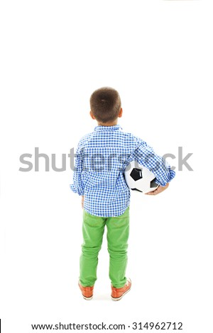 Back view of a child holding a soccer ball. Isolated on white background  - stock photo