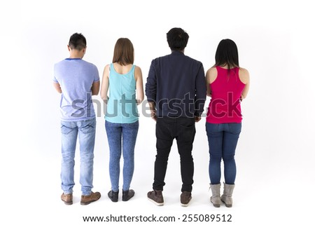 Back view of a Group of friends. Isolated on a white background. - stock photo