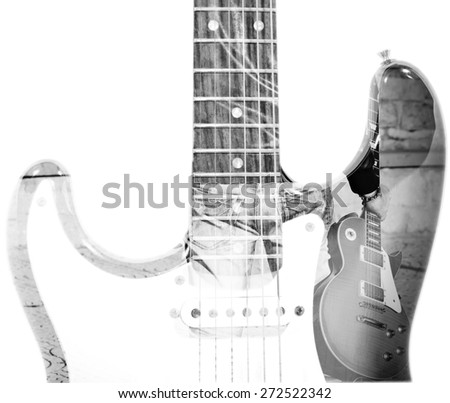 back view of a man holding a guitar and guitar silhouette in double exposure in black and white - stock photo