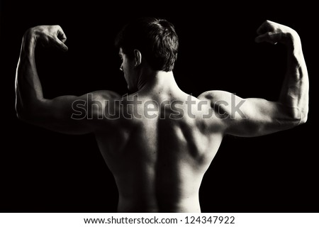 Back view of a muscular young man in black and white. - stock photo
