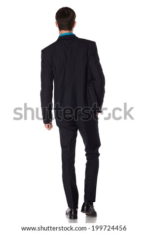 Back view of a walking business man looking to his side on white background
