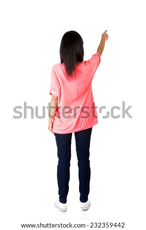 Back view of a woman pointing up. - stock photo