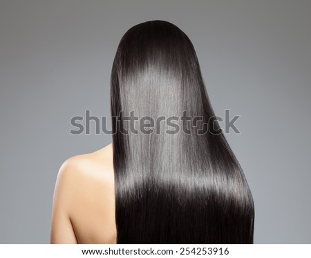 Back view of a woman with long straight hair - stock photo