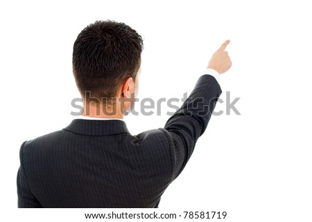 Back view of a young business man pointing at something over white background - stock photo