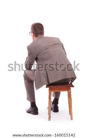 back view of a young business man sitting on a chair. on a white background - stock photo