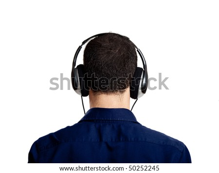 Back view of a young man listening music with headphones, isolated on white - stock photo