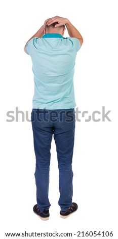 Back view of angry young man in jeans and shirt. Rear view. isolated over white. backside view of person.  Rear view people collection. Isolated over white background. - stock photo