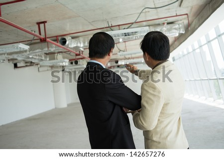 Back view of business colleagues working on the project together - stock photo