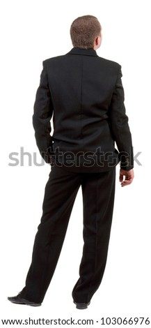 back view of business man in black suit  watching.   Businessman looks up  Isolated over white background. Rear view people collection. backside view of person. - stock photo