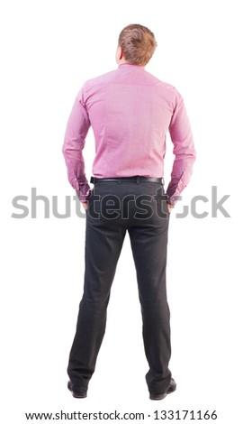 back view of business man in red shirt looks ahead. Young businessman watching.  Rear view people collection. backside view of person.  Isolated over white. office worker with sports figure looks away - stock photo