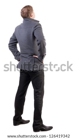 back view of Business man  looks ahead. Young guy in coat watching.  Rear view people collection.  backside view of person.  Isolated over white background. - stock photo